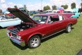 muscle car with hood open