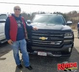 Runde Chevrolet Customer Leonard H. pictured in front of new Colorado truck