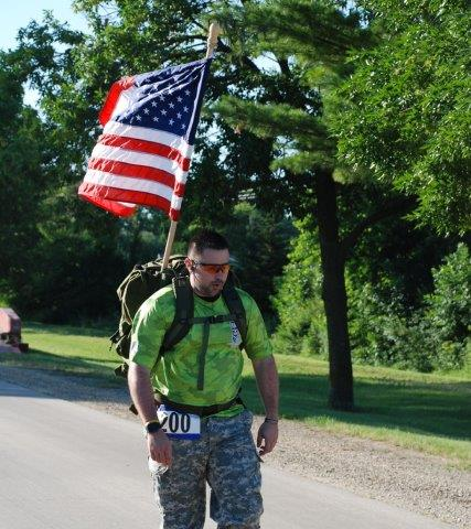 Run4Troops participant carrying a US flag