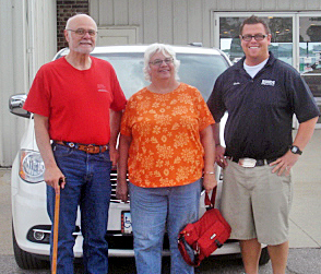 Paul and Tarrill A. and their 2011 Chrysler Town & Country.