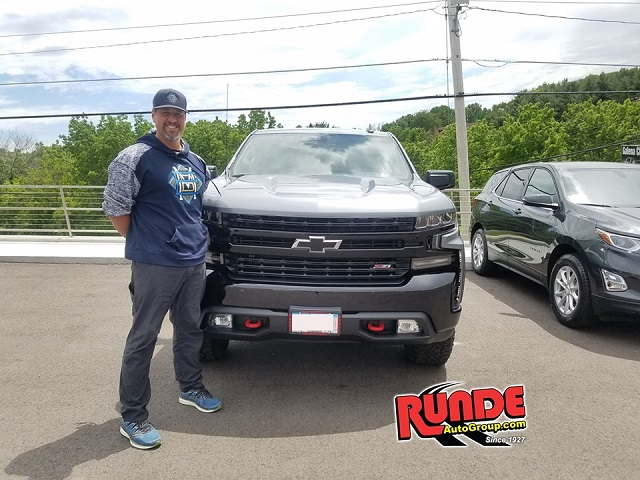 Eric Munson of Dubuque at Runde Chevrolet with his new Silverado
